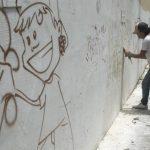 La eliminación de grafitis es la primera acción de segunda fase de tregua entre pandillas. FOTO EDH