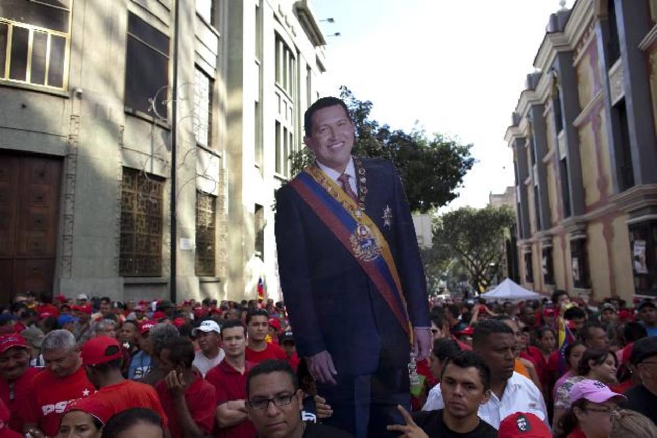 Simpatizantes del presidente Chávez durante una manifestación de apoyo en Caracas. FOTO AP
