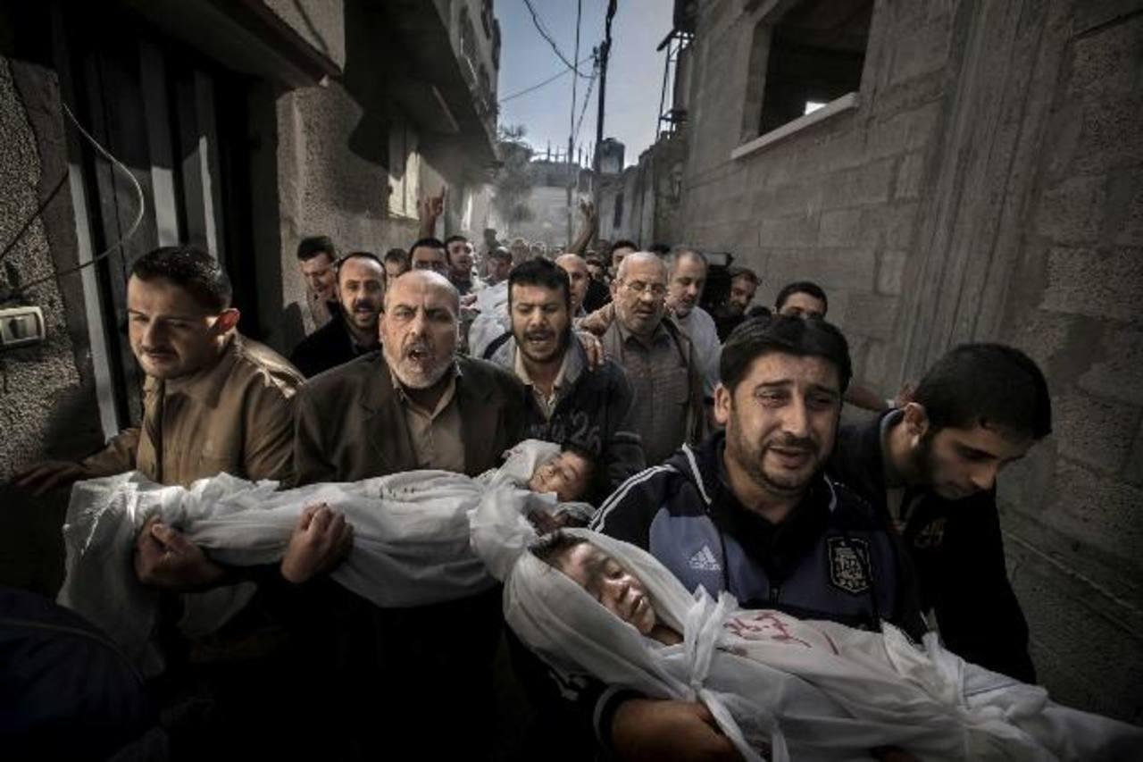 Funeral en Gaza, la fotografía del año en el World Press Photo 2013. Su autor es el sueco Paul Hansen.