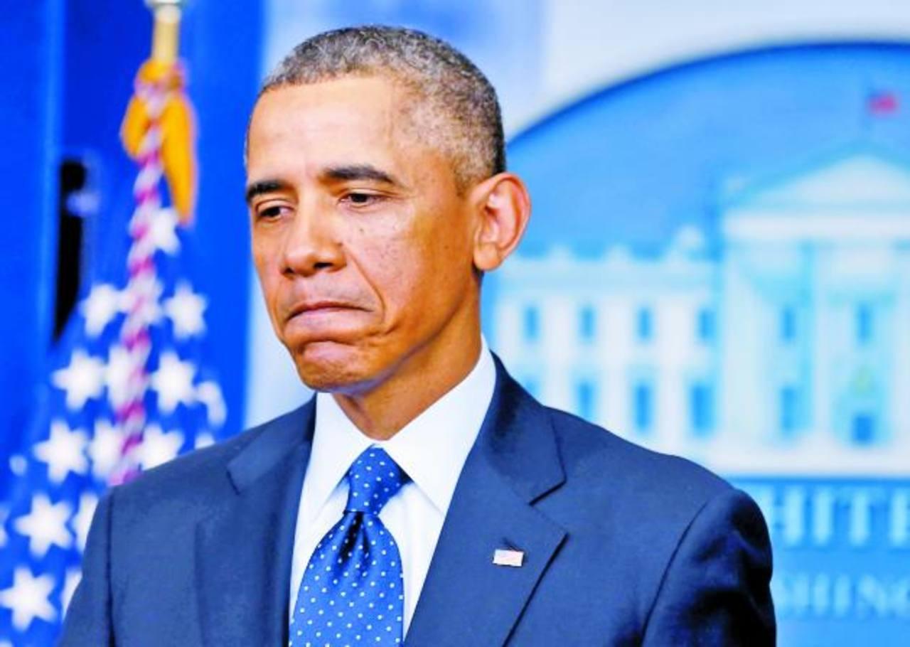 Al presidente Obama se le vio cabizbajo ayer luego de la reunión con líderes republicanos y demócratas en un afán por detener la entrada en vigencia de los recortes presupuestarios. foto edh / REUTERS