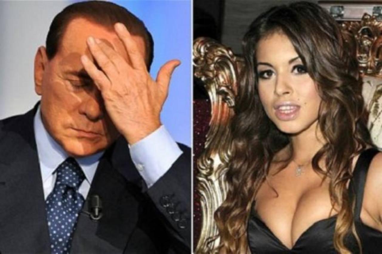 El exprimer ministro Silvio Berlusconi y la joven Karima el Mahroug, alias Ruby rompecorazones. foto edh /