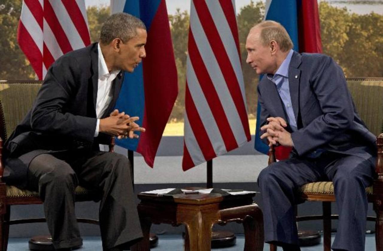 Después de un encuentro bilateral de más de dos horas, los presidentes de EE.UU., Barack Obama (izquierda), y de Rusia, Vladimir Putin, cerraron la primera jornada del G8. foto edh / ap