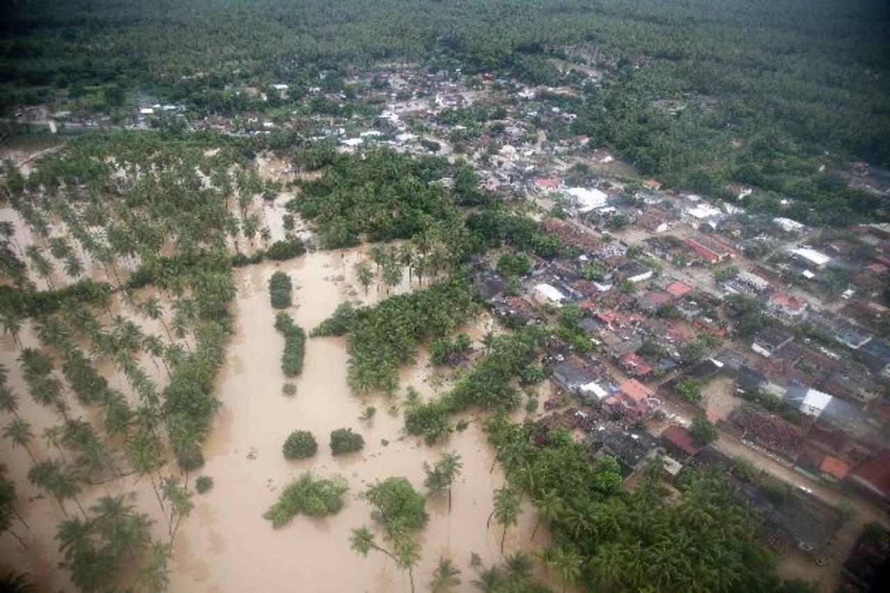 """Vista aérea de San Jerónimo inundado por las devastadoras tormentas causadas por el huracán """"Manuel"""". foto edh / ap"""