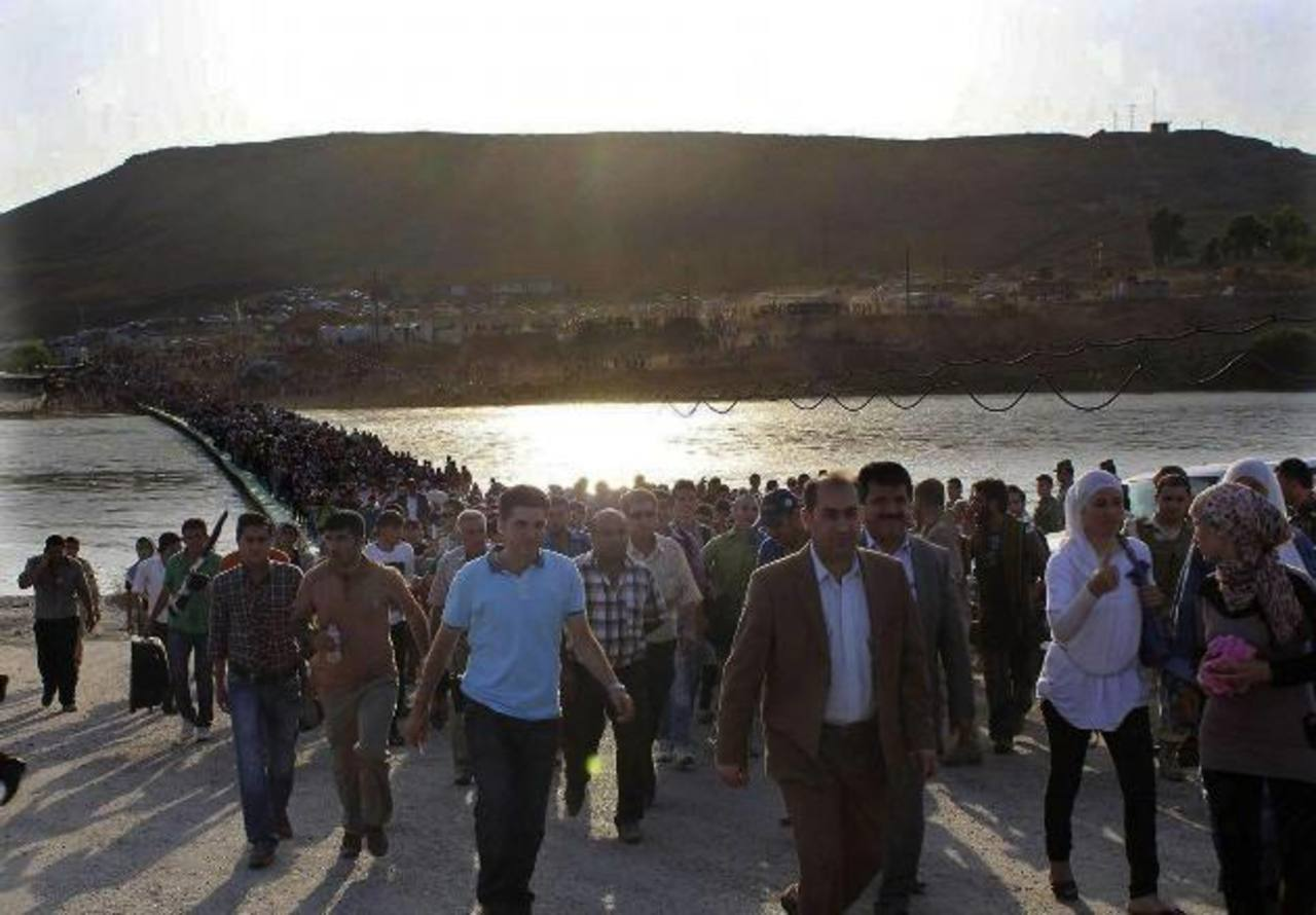 Mientras EE.UU. debate intervenir en Siria, miles de refugiados sirios cruzan hacia Irak. Ya son seis millones de desplazados. EFE