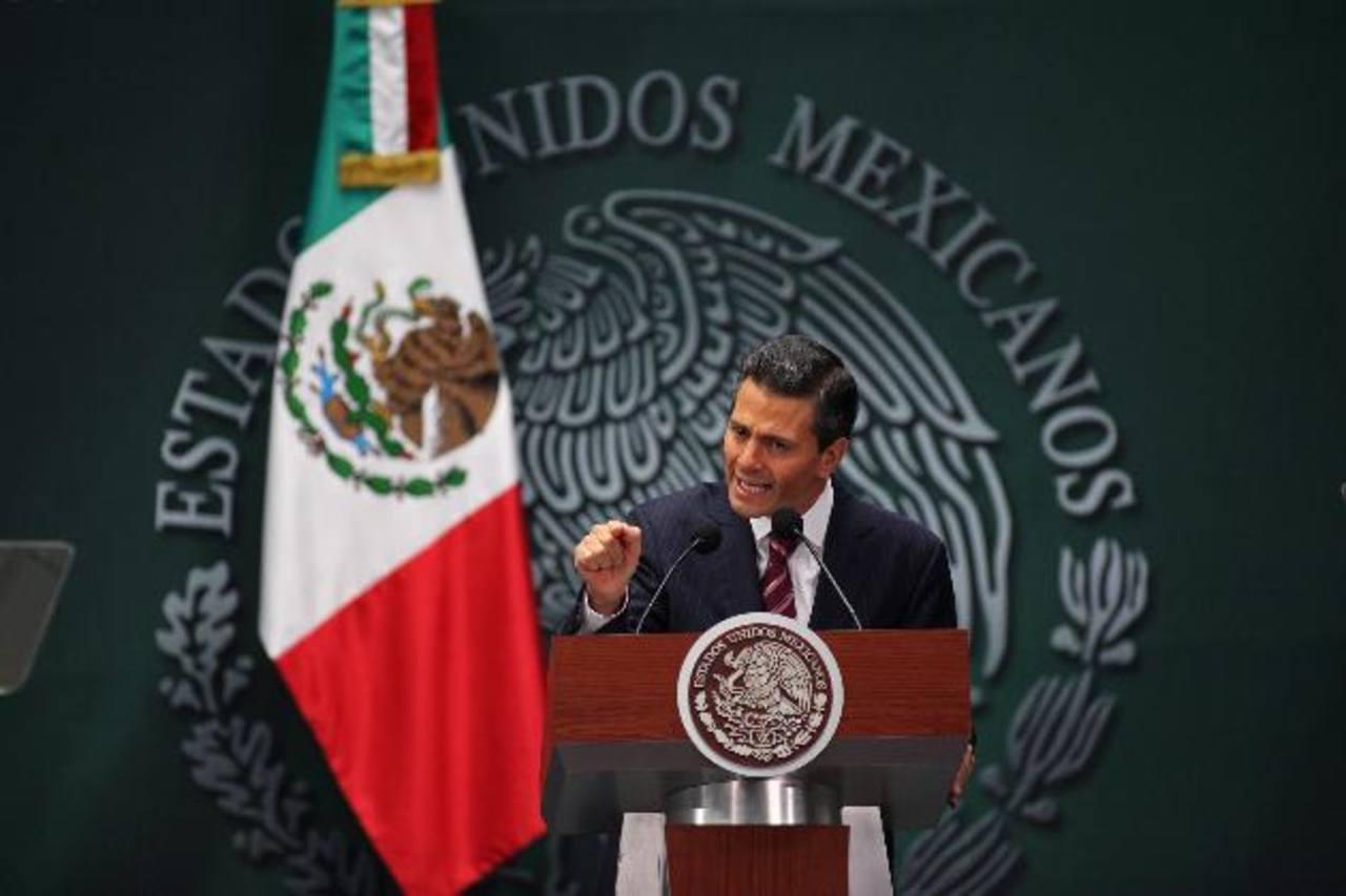 """Peña Nieto reiteró ayer que """"no habrá marcha atrás"""" en la aplicación de otra de sus reformas: la educativa. foto edh /EFE"""