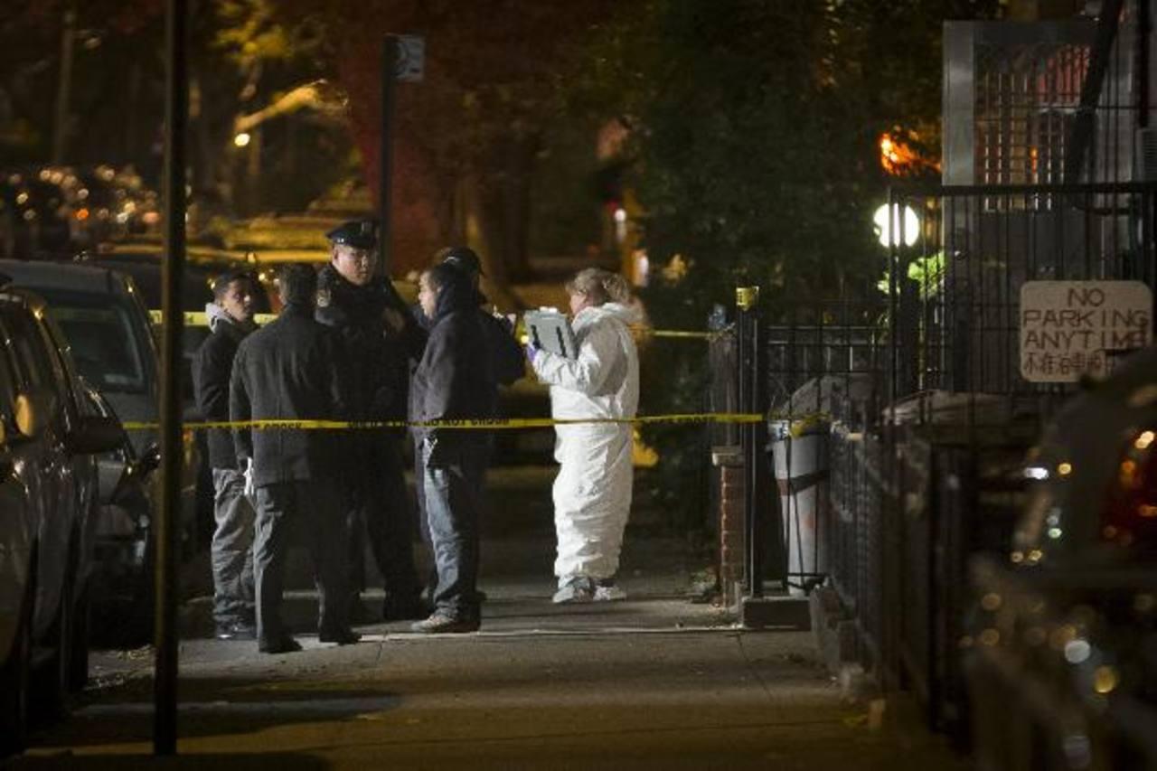 Un inmigrante chino fue detenidos acusado de asesinar a cinco personas, entre ellas cuatro niños. Foto/ AP