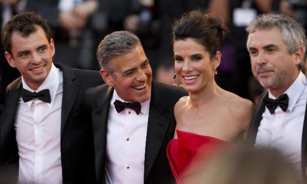 George Clooney, Sandra Bullock y Alfonso Cuaron en la pasada exhibición en el Festival de Cine de Venecia. Foto EDH / aP