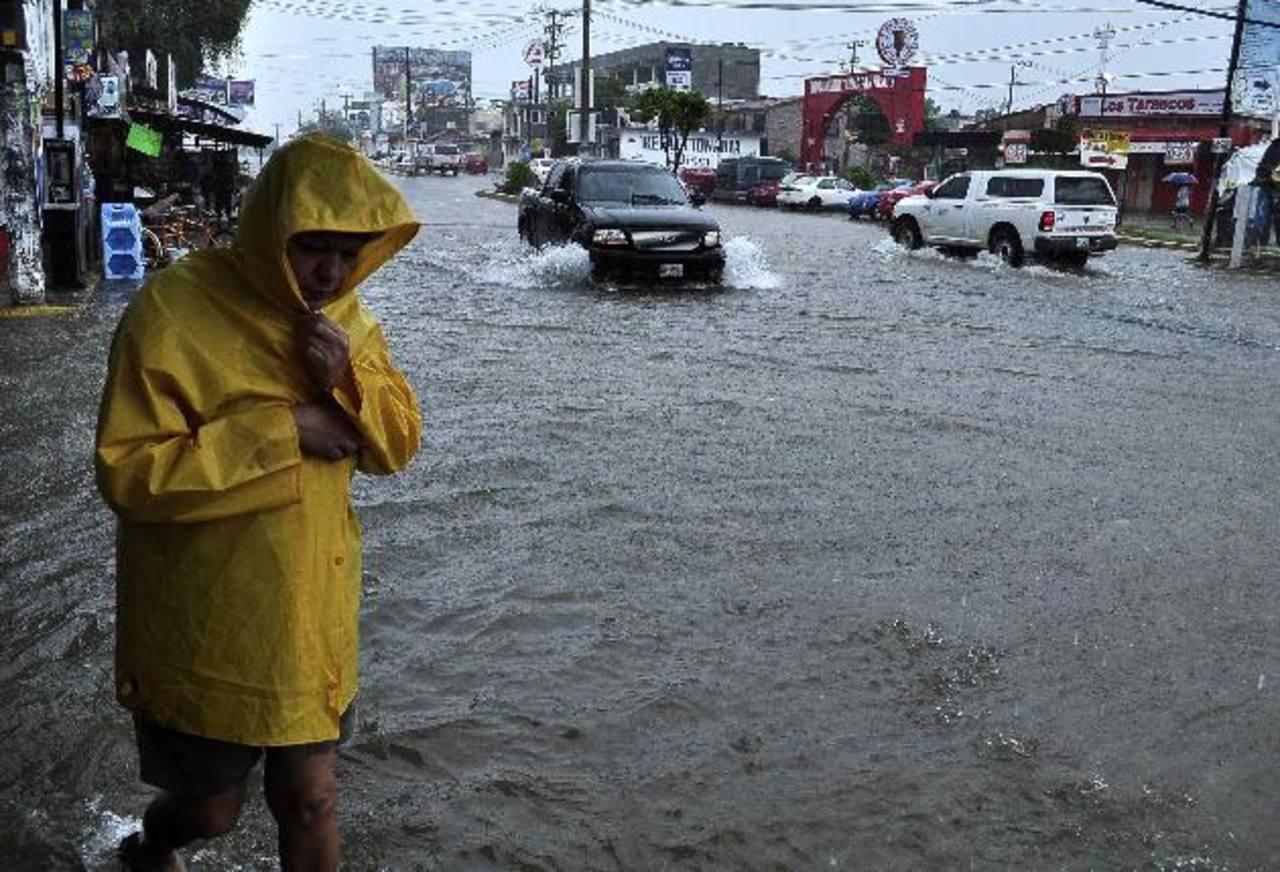 MIles de mexicanos han tenido que abandonar sus viviendas debido a las fuertes tormentas que afectan el país. Foto edh/reuters