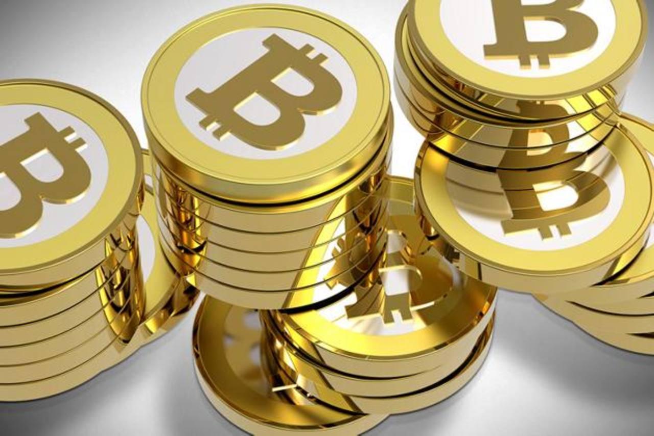 Bitcoin es la primera moneda electrónica descentralizada, es decir, que no está controlada por una sola organización o gobierno. Muchos la han adoptado. Foto EDH / archivo