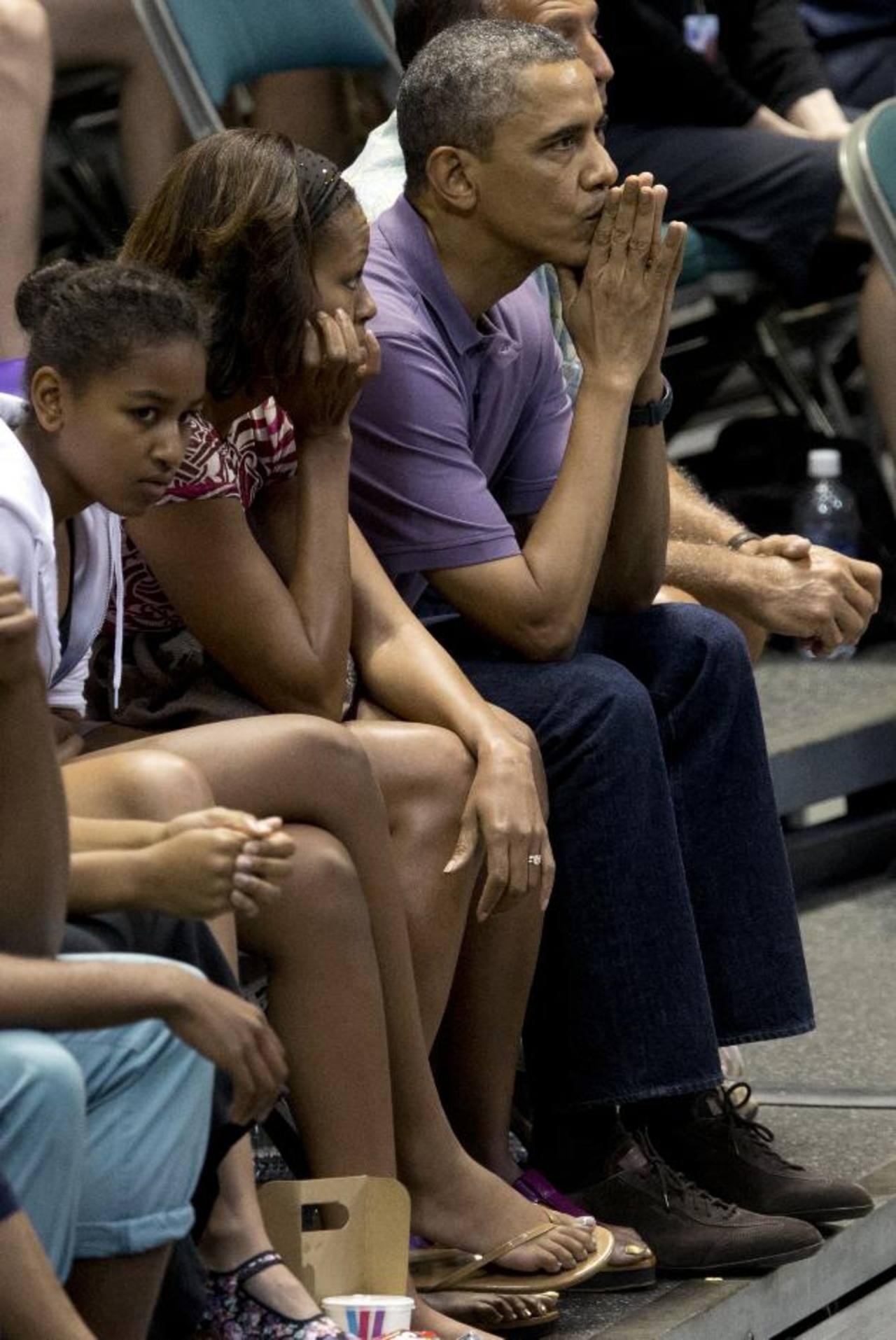 Desde la izq.: Sasha Obama (hija), Michelle Obama y Barack Obama, durante sus vacaciones de Navidad en Hawai. foto edh /AP