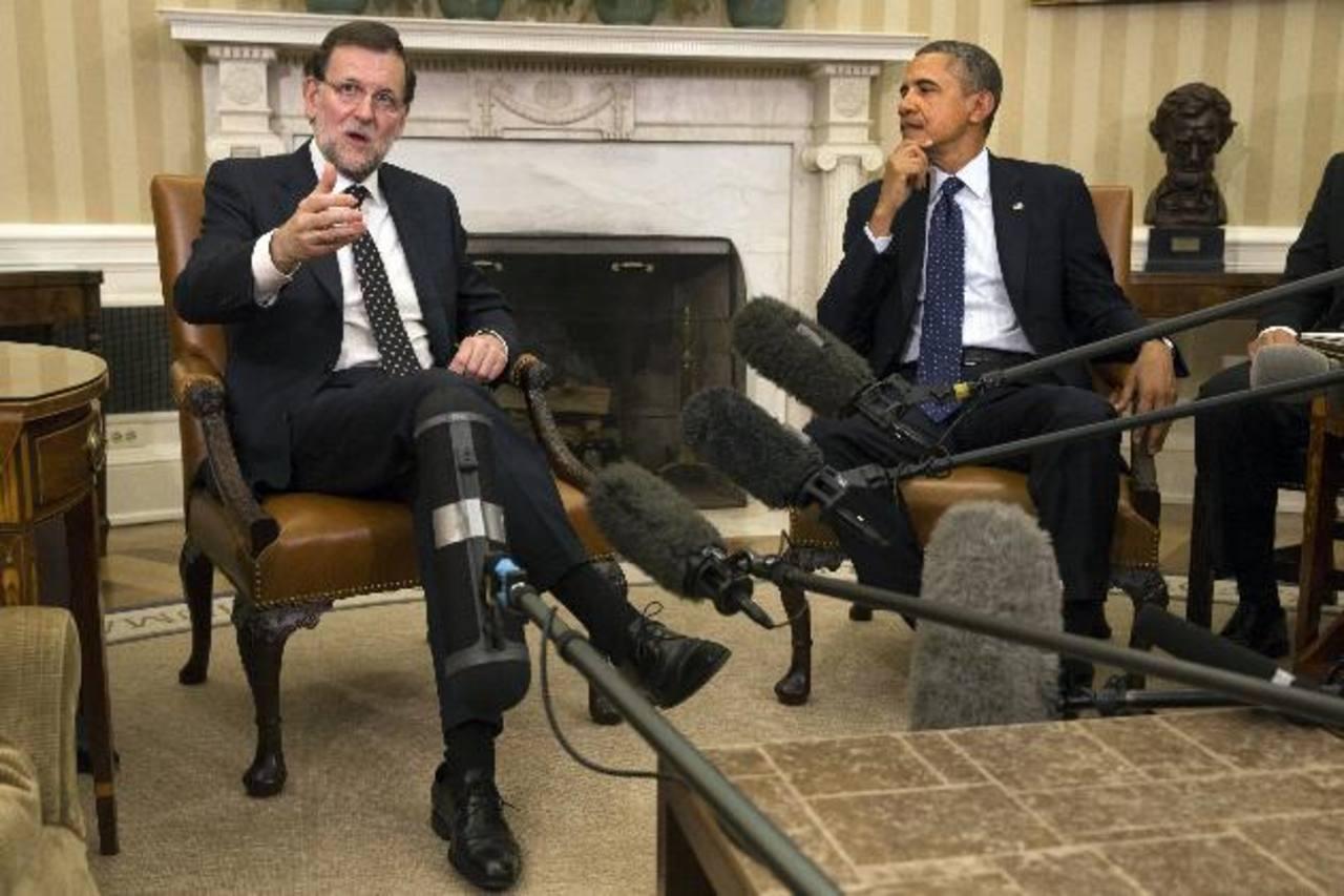 El jefe del gobierno español, Mariano Rajoy (iz) y el presidente de EE. UU., Barack Obama durante su reunión. foto edh / ap