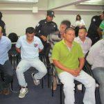 Carlos Alfonso Valencia Amaya (centro, camisa verde) narcotraficante que disparó contra dos agentes encubiertos. Era la mano derecha de Sanabria Amaya (izq.). Foto EDH / Jorge Beltrán