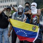 Opositores al Gobierno venezolano se manifiestan en las calles de Caracas. Foto AP