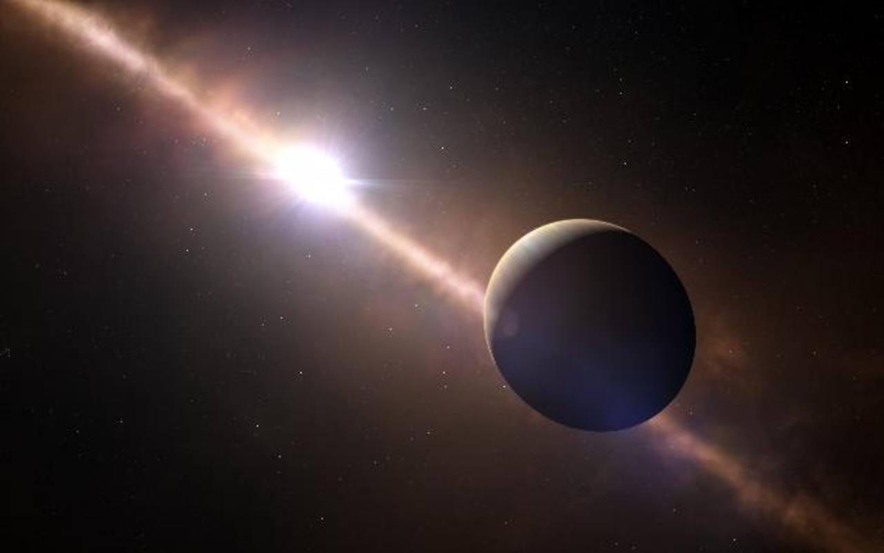 Esta impresión artística muestra al planeta orbitando alrededor de la joven estrella Beta Pictoris.