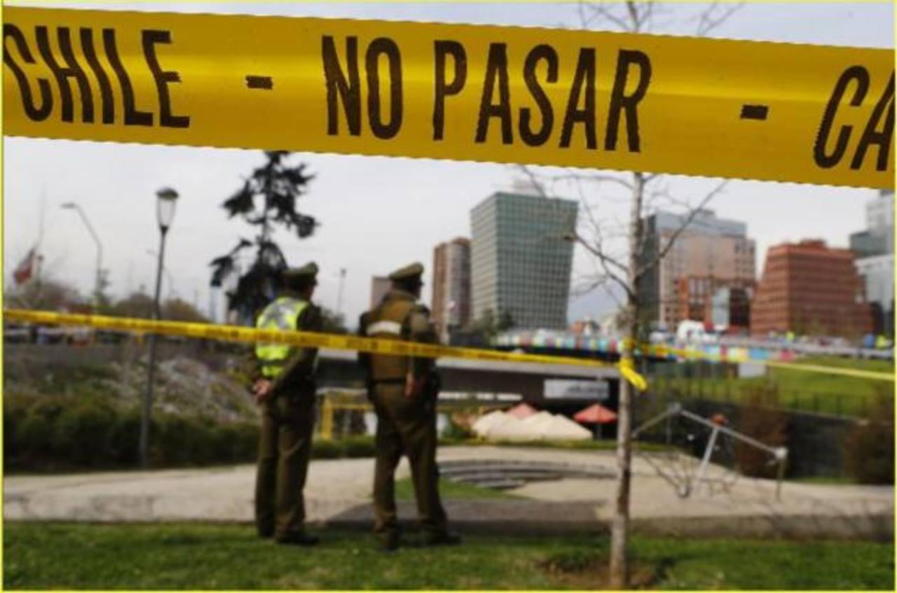 Policías resguardan escena del atentado.