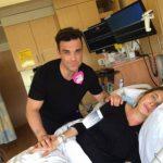 Robbie Williams canta a su mujer durante labor de parto