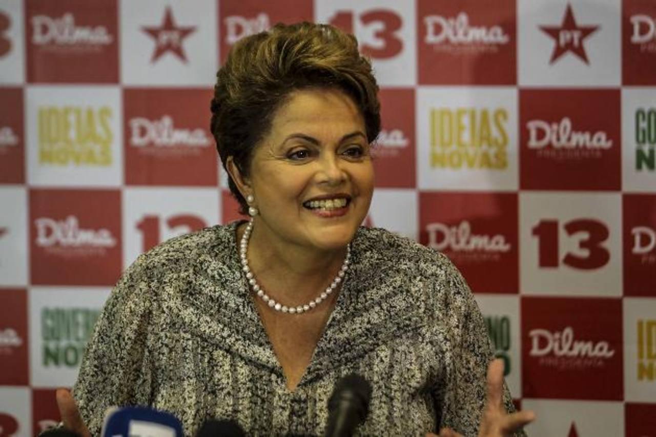 La actual presidenta Dilma Rousseff y Aecio Neves son los contendientes para la segunda vuelta electoral que se realiza este domingo en Brasil. foto s edh / EFE