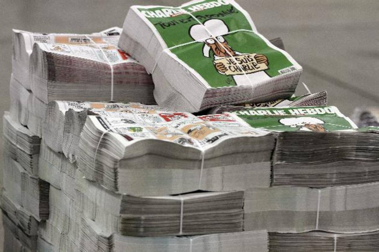 Los paquetes del próximo número del semanario Charlie Hebdo, en el centro de distribución en Nantes, Francia. foto edh / efe