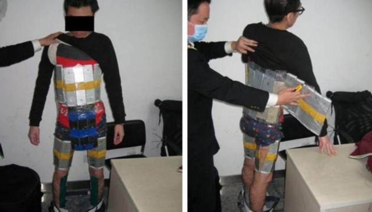 Hombre trató de ingresar 94 iPhones atados al cuerpo
