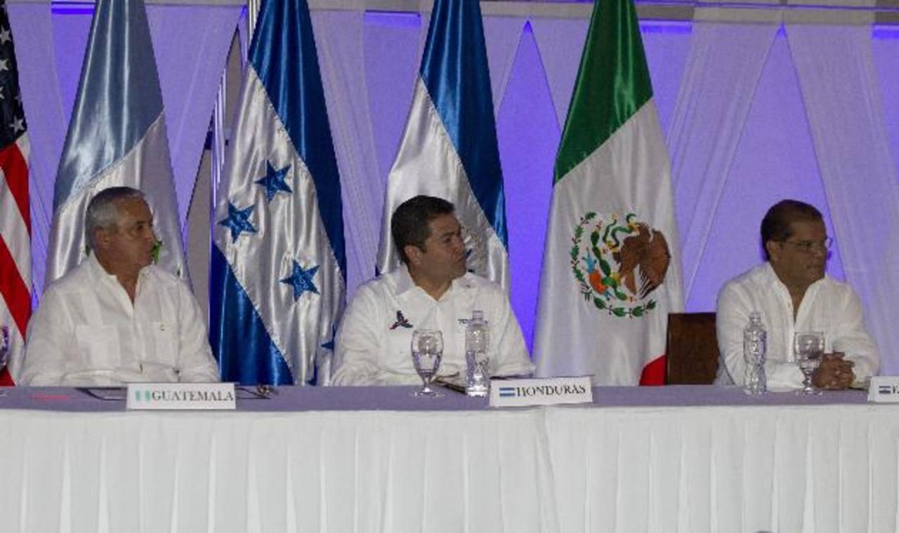 Otto Pérez, Juan O. Hernández y Óscar Ortiz ayer en Tela.