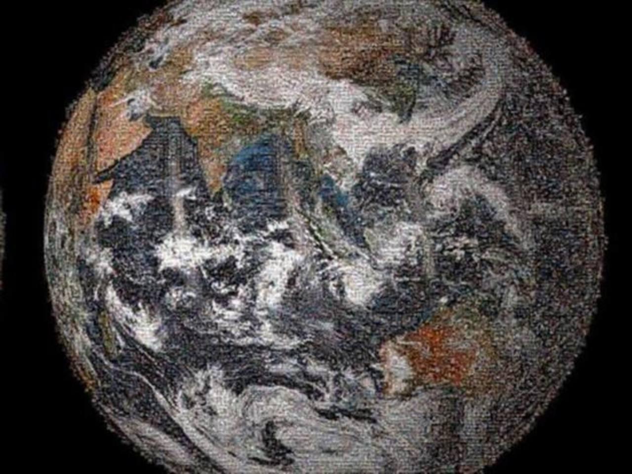 Mosaico creado con los selfies compartidos en las redes sociales con la etiqueta #GlobalSelfie en 2014.