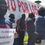 Policías exigen salario de mil dólares