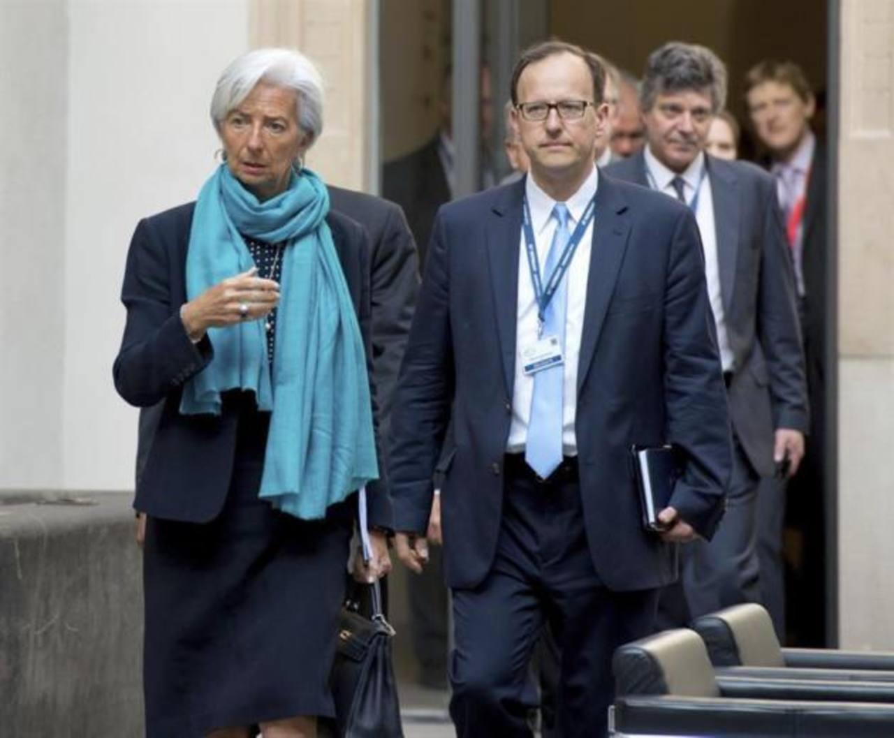 La directora gerente del Fondo Monetario Internacional (FMI), Christine Lagarde (izda).