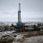 An oil derrick is seen at a fracking site for extracting oil outside of Williston
