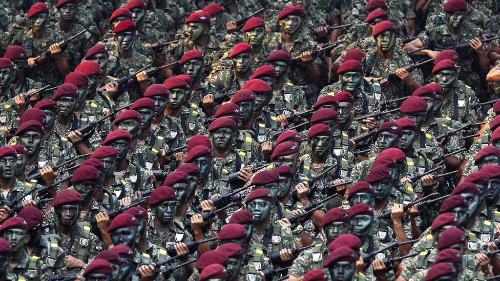 Malaysian Army personnel march during the 58th National Day celebrati