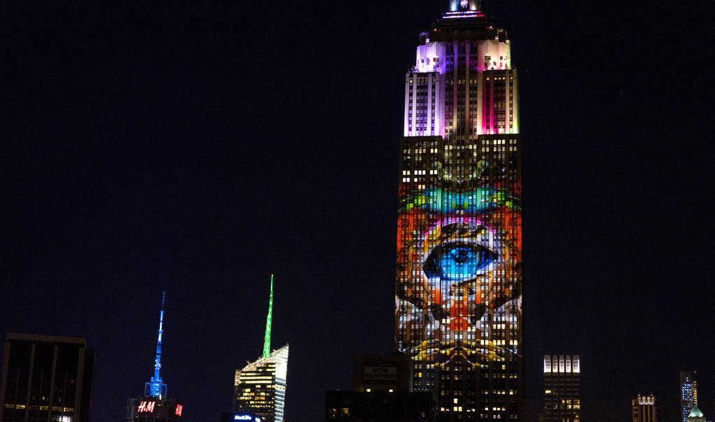 Large images of endangered species are projected on the south facade