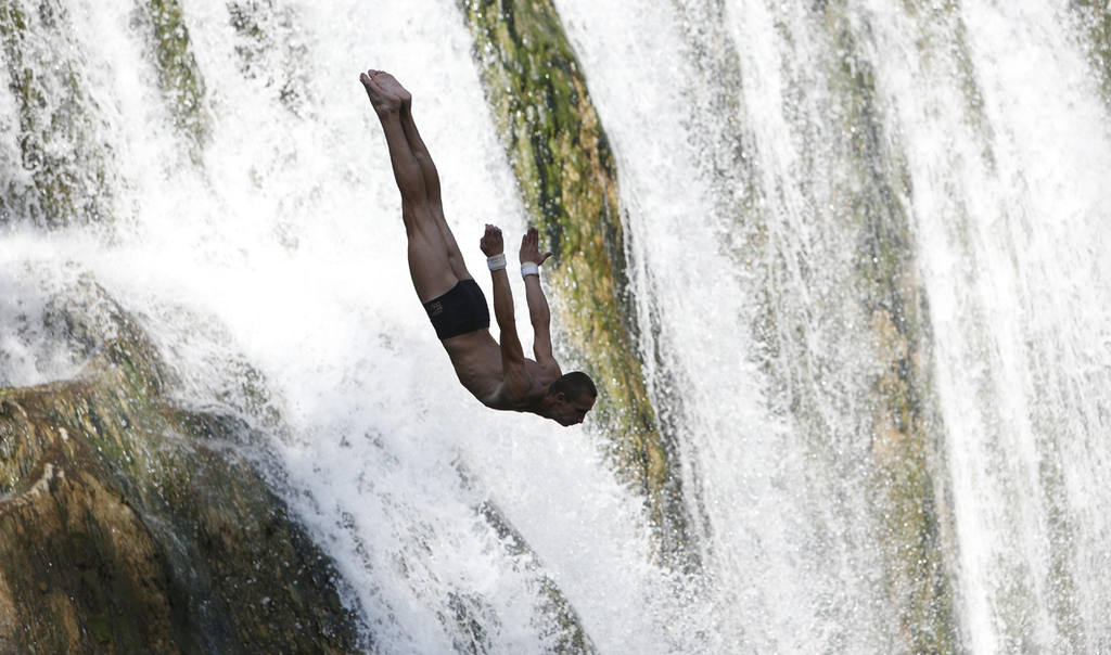 A competitor dives during the international waterfall jumping competi