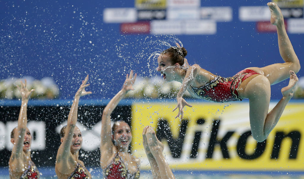 The gold medal team of Russia performs during the synchronised swimmi