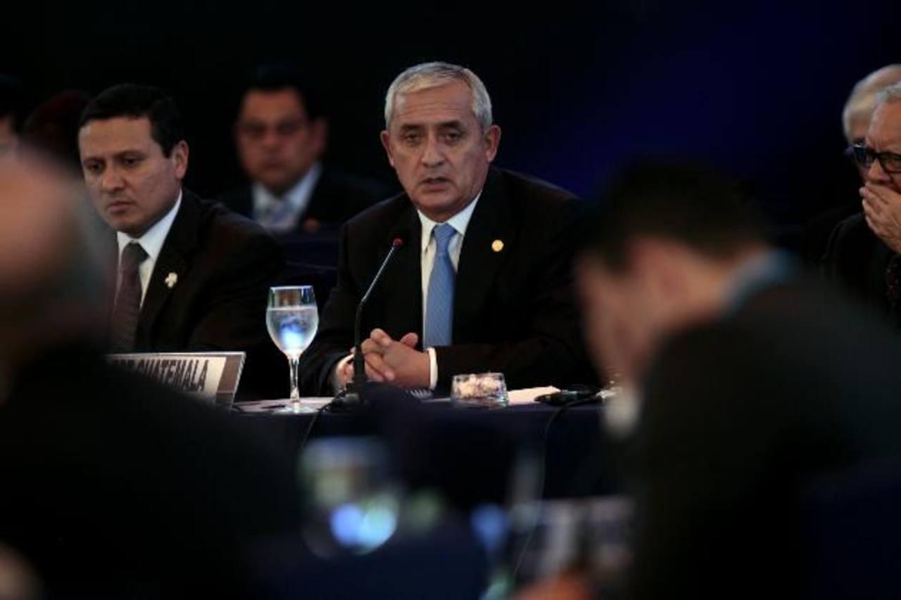 El presidente de Guatemala, Otto Pérez Molina (c), en la XLV Cumbre de Jefes de Estado y de Gobierno del Sistema de Integración Centroamericana (SICA), el 26 de junio. foto edh / efe