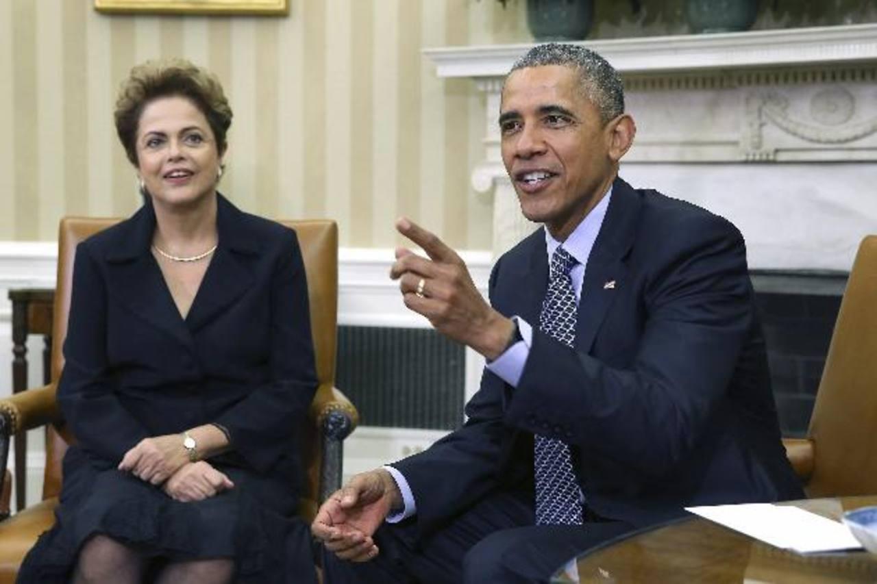 El presidente de EE. UU., Barack Obama (d), junto a su homóloga brasileña, Dilma Roussef (i), en la Casa Blanca. foto edh / AP