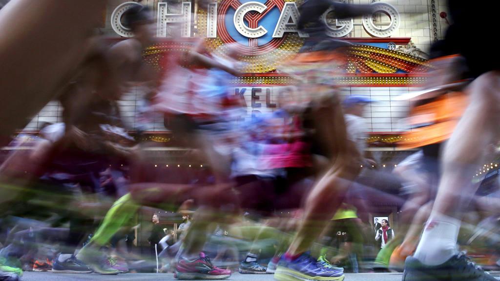 Runners participate in the Chicago Marathon, Sunday, Oct.