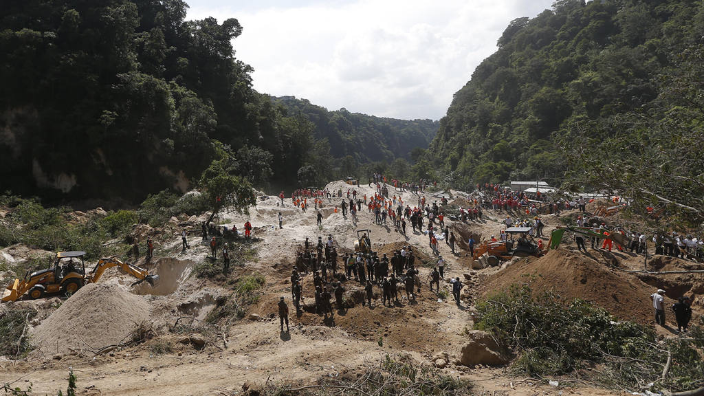 Rescue workers search for survivors of a mudslide in Santa Catarina P