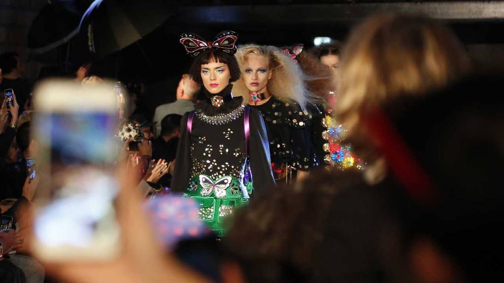 Models wears creations by Indian designer Manish Arora  as part of hi