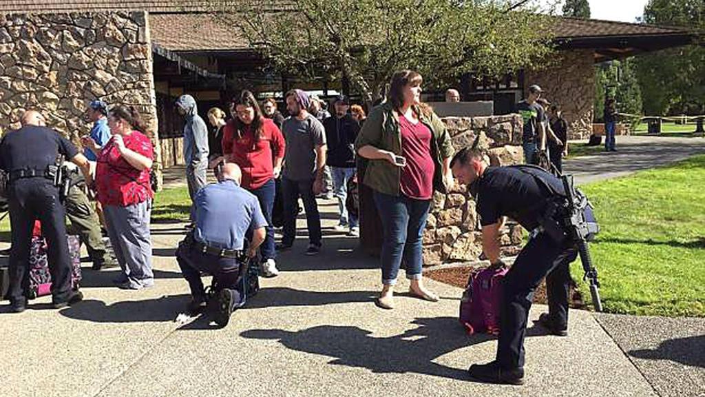 Police search students outside Umpqua Community College in Roseburg