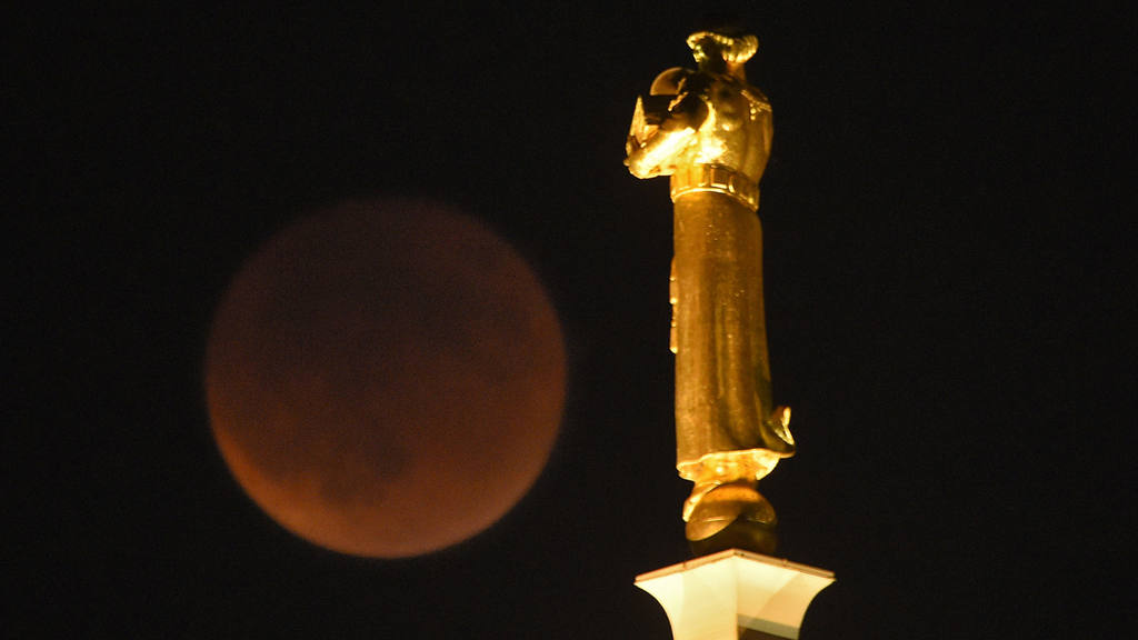 Earth's shadow obscures the view of a so-called supermoon next to the