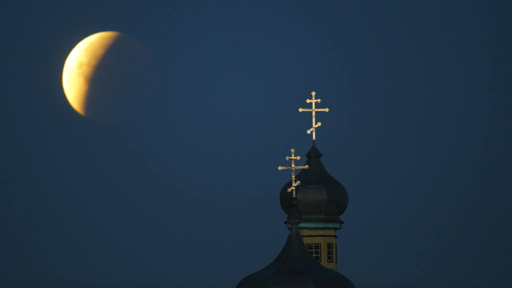 A so-called supermoon is seen at the finish of a lunar eclipse behind