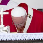 Pope Francis kisses the altar as he arrives to celebrate Mass at the