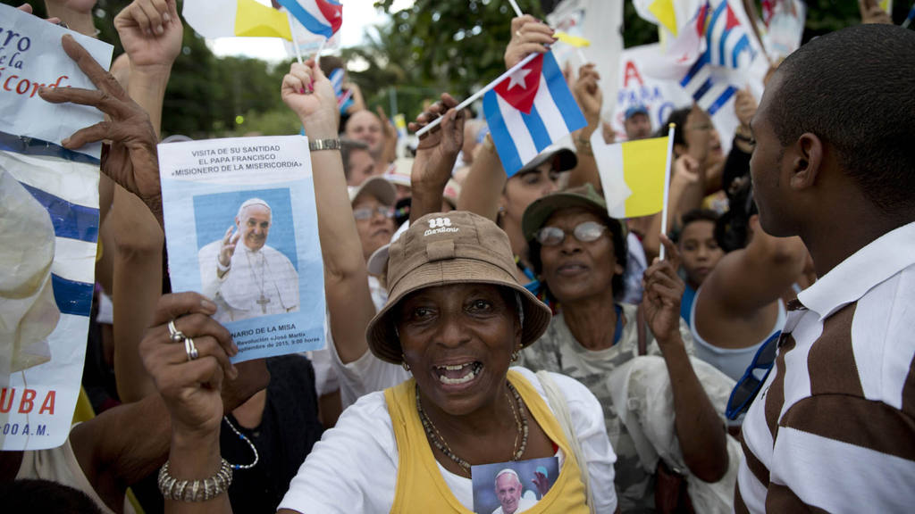Women sing upon Pope Francis' arrival to the Apostolic Nunciature in