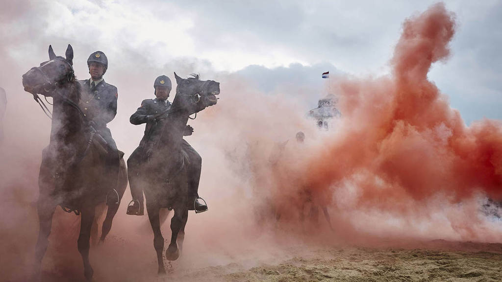 AP10ThingsToSee - Smoke from grenades shrouds horses and riders durin