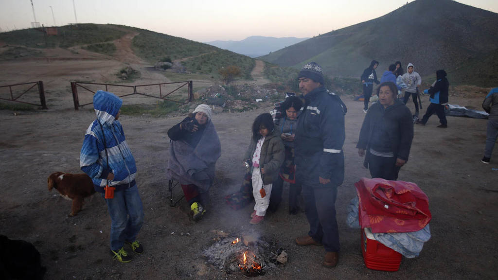 A family allows their campfire to go out after spending the night on