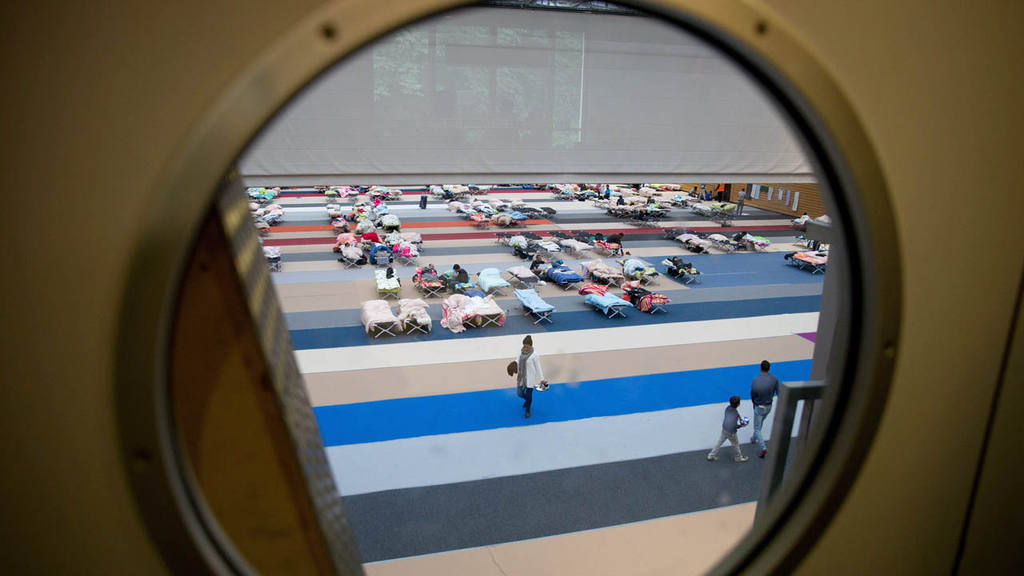 Refugees accomodated in Olympic Park sports arena in Berlin
