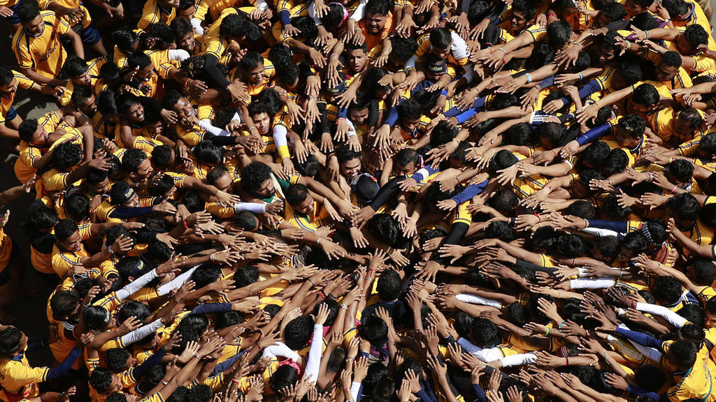 Indian youth form a human pyramid to break the