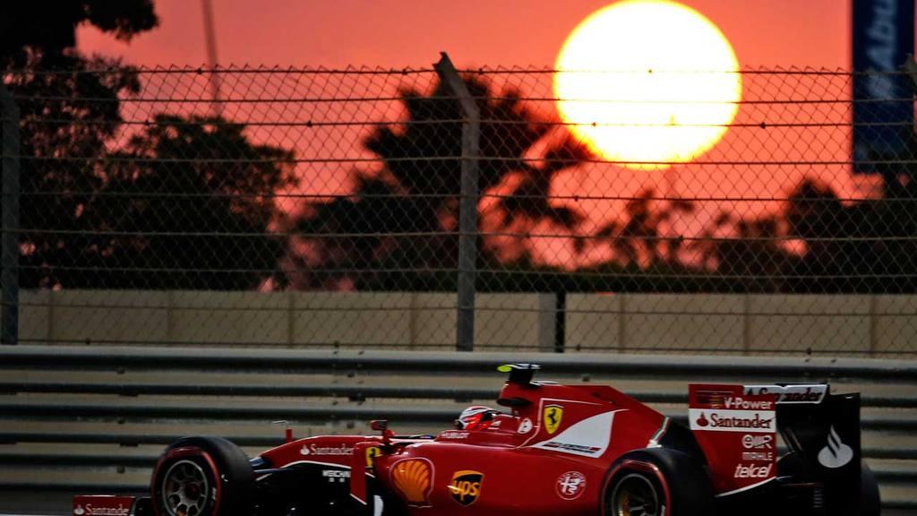 Ferrari driver Kimi Raikkonen of Finland drives past the sunset durin