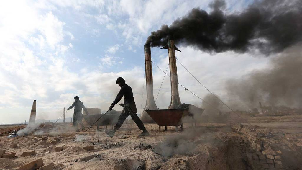Afghan day laborers work at a brick factory on the outskirts of Kabul