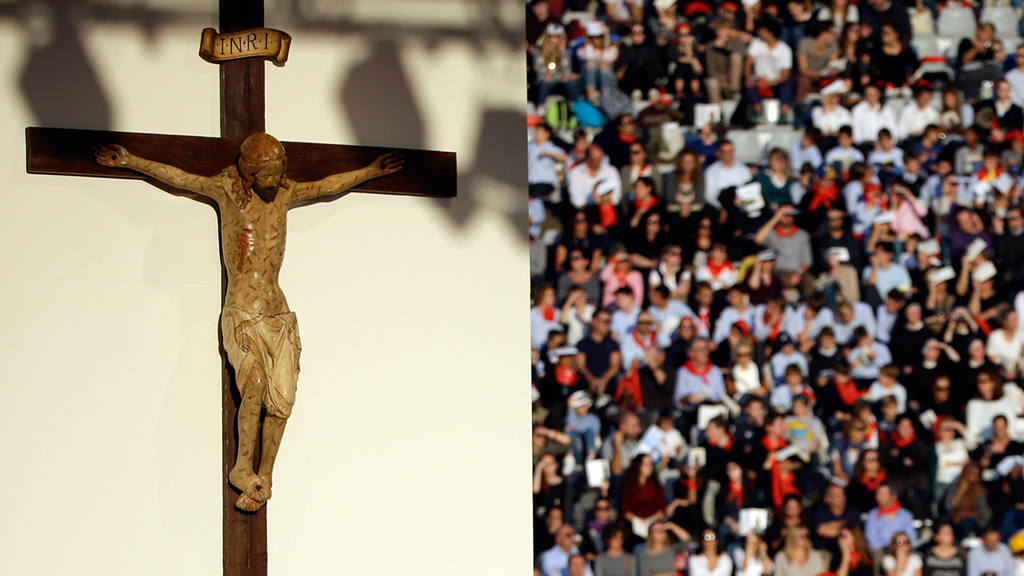 A wooden crucifix towers over the altar during a Mass celebrated by P
