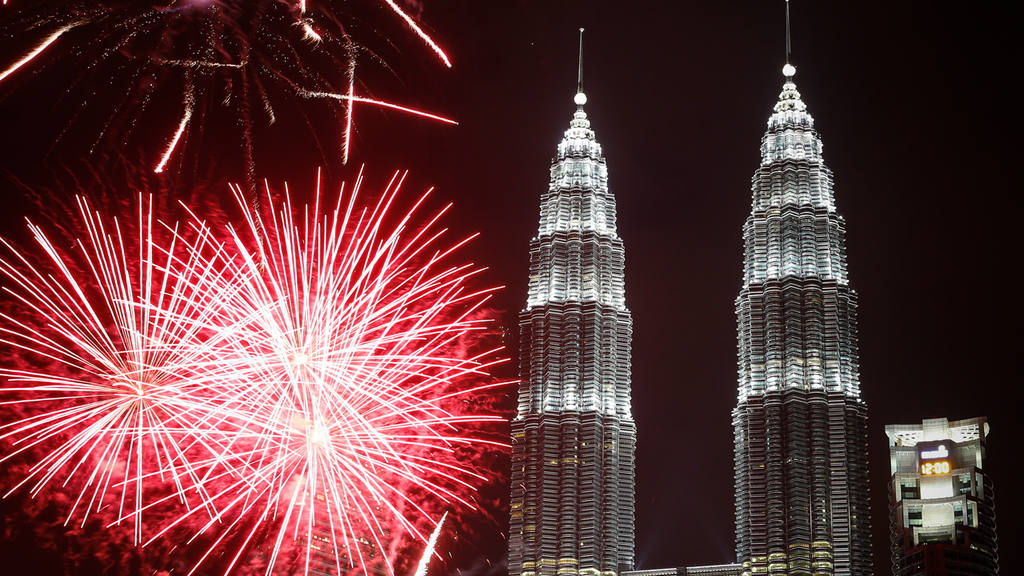 Fireworks explode in front of Malaysia's landmark building